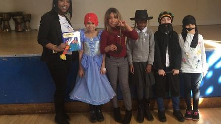 Nyesha Jones with pupils from Tyssen Primary School who dressed up as the characters in her book Dre