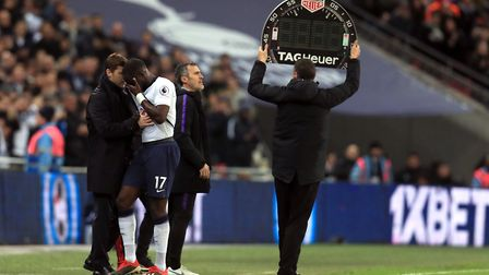 Tottenham Hotspur's Moussa Sissoko is consoled by manager Mauricio Pochettino as he is substituted w
