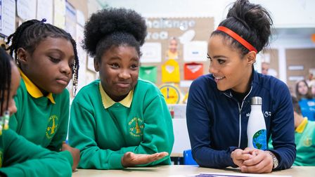 Former England footballer Alex Scott meets Angel and Tianna, from year 6 at Princess May Primary Sch