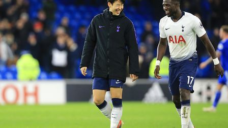 Tottenham Hotspur's Heung-min Son (left) and Moussa Sissoko after the Premier League match at Cardif