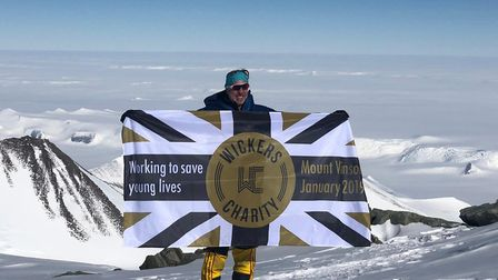 Henry Smith with the Wickers charity flag.