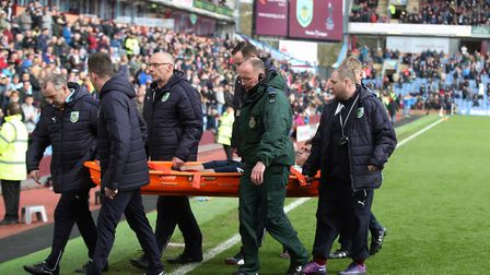 Tottenham Hotspur's Harry Winks is stretchered off with an injury during the Premier League match ag