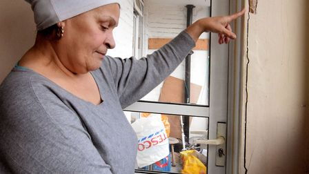 Celia Osei points to cracks which appeared around her door at Tollgate House. Picture: Polly Hancock