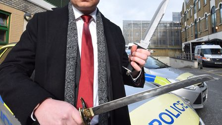 DI Paul Ridley with 2 of the 369 blades recovered in 2017 by Hackney Police. Picture: Polly Hancock
