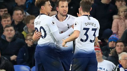 Tottenham Hotspur's Harry Kane celebrates scoring with team mates Dele Alli (left) and Ben Davies (p