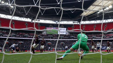 Tottenham Hotspur's Heung-min Son (left) scores his side's first goal of the game during the Premier