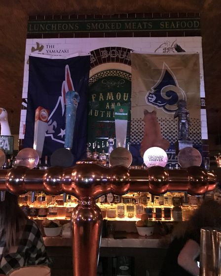 New England Patriots and Los Angeles Rams flags behind the bar at the Blues Kitchen (Pic: Jacob Rans