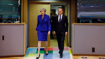 European Council President Donald Tusk arrives with British Prime Minister Theresa May to attend the