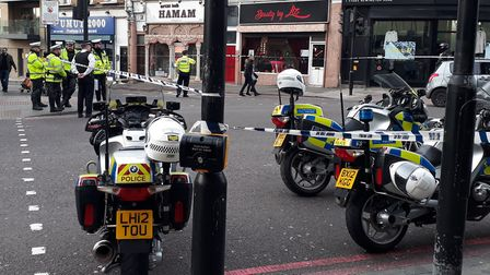 Police at the scene of the moped crash at the junction of Kingsland High Street and Stoke Newington