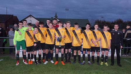 The winning Year 10 team is presented with the trophy. Shirley D Whitlow's photograph of the Rory Da