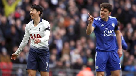 Tottenham Hotspur's Heung-min Son (left) and Leicester City's Harry Maguire exchange words during th