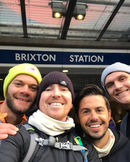 Dan Sherry with friends after completing his run alongside the Victoria Line. Picture: Dan Sherry