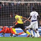 Tottenham Hotspur goalkeeper Hugo Lloris makes a save from Borussia Dortmund's Dan-Axel Zagadou duri