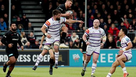 Saracens' Nick Isiekwe (centre) clutches the ball in the air above Leicester's Mike Fitzgerald (pic