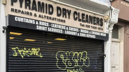 Graffiti like this on shutters at Pyramid Dry Cleaners in Belsize Lane is a problem. Photo: MARIO MI