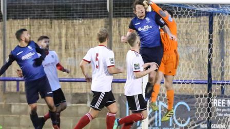Wingate & Finchley captain Sean Cronin challenges for the ball (pic: Martin Addison).