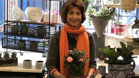 Judy Green holds a plant inside her Garden Store in Flask Walk, Hampstead. Picture: Catherine Wiltsh