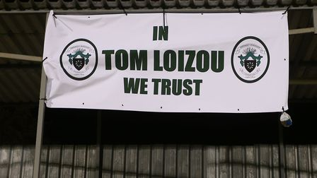A Haringey Borough flag in support of long-serving, successful manager Tom Loizou (pic: George Phill