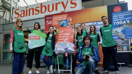 Camden Greenpeace get ready to return their shopping trolley full of plastic to Sainsbury's. Picture
