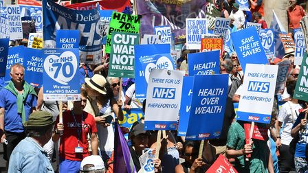 People marched in central London to mark the 70th anniversary of the NHS. Photo: JOHN STILLWELL/PA