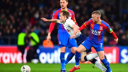 Tottenham Hotspur's Oliver Skipp and Crystal Palace's Max Meyer (right) battle for the ball during t