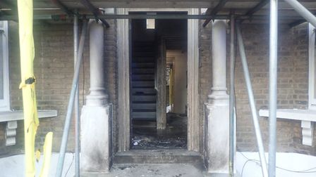 The fire at the suspected cannabis factory damaged the ground floor hallway. Picture: @LondonFire
