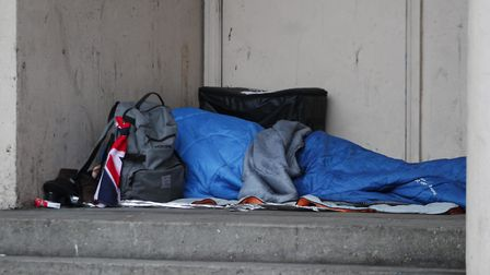 A homeless person sleeping rough in a doorway in London. Picture: Yui Mok/PA Wire