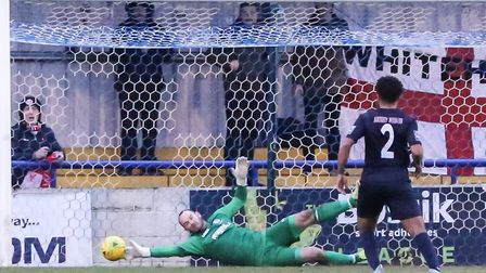 Wingate & Finchley goalkeeper Shane Gore gets down low to make a save against Whitehawk (pic: Martin
