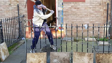 Armed with pick-axes, crowbars and sledgehammers, the helpers broke up concrete front yards, brick w