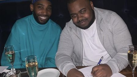 Anthony Bunbury (right) signing a deal with Tinie Tempah
