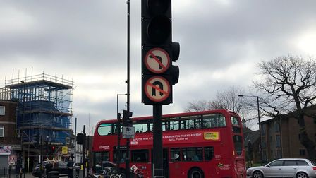 """A """"no left turn"""" sign at Bounds Green. Here it is on the traffic light post, rather than behind it."""
