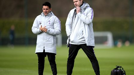 Tottenham Hotspur manager Mauricio Pochettino (right) and assistant manager Jesus Perez observe the