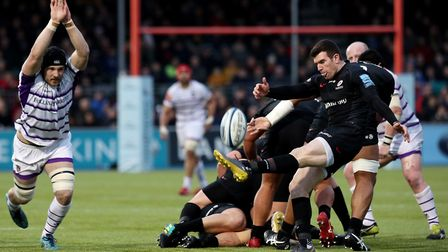 Saracens' Ben Spencer (right) makes a clearing kick in front of Leicester's Harry Wells (pic Jonatha