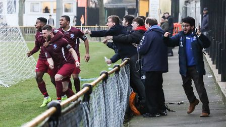 Wingate & Finchley players celebrate their late goal at Folkestone Invicta with the fans (pic: Marti