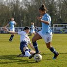 Ashleigh Neville, of Tottenham Hotspur Ladies, tries to tackle Manchester City Women ace Nikita Parr