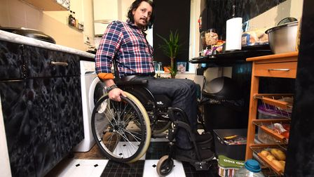 Michael Knight's kitchen is too narrow to turn his wheelchair around in.
