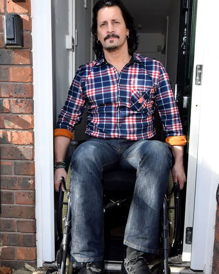 Michael Knight can barely get his wheelchair out of his front door.