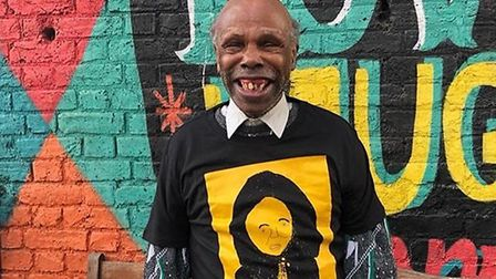 Cecil Waldron of Submit to Love Studios wearing his Alice Coltrane t-shirt design.