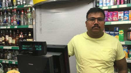 Mr Sivapathasumtharam at the counter of his shop in Lowestoft. Picture: Conor Matchett