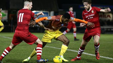 Reece Beckles-Richards of Wingate & Finchley and Charlie Stimson of Hornchurch battle for the ball (