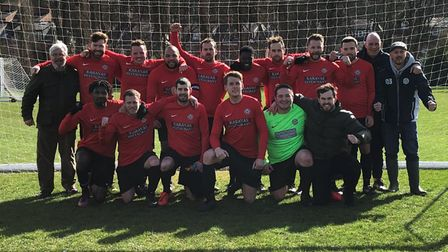 Highgate Albion third-team players and staff face the camera