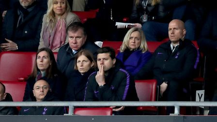 Tottenham Hotspur manager Mauricio Pochettino (centre) appears dejected in the stands at the end of