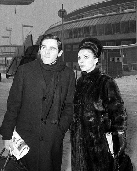 Anthony Newley and his wife, actress Joan Collins, at London's Heathrow Airport.
