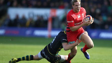 Northampton Saints' Alex Mitchell (left) tackles Saracens' Max Malins (pic: Nigel French/PA)