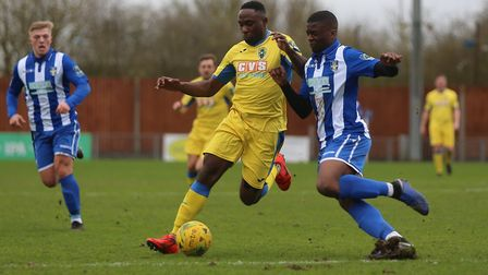 Kudus Oyengua of Haringey Borough attempts to get past Bishop's Stortford's on-loan Leyton Orient de
