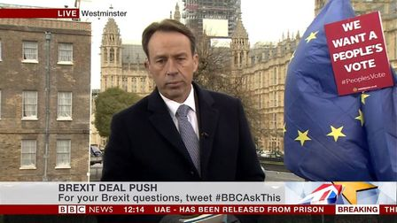 BBC News' Ben Brown struggles with the persistent anti-Brexit campaigners behind him. (Photograph: B