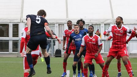 Sean Cronin heads home the opening goal of the game for Wingate & Finchley in their 7-2 win at Harlo