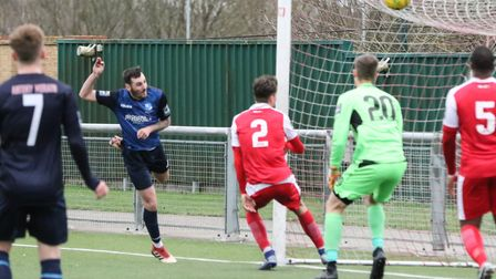 Wingate & Finchley's Charlie Cole heads home their sixth goal of the game away to Harlow Town (pic: