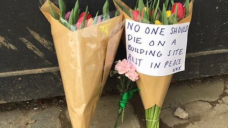Flowers are being left at the scene in Swain's Lane where a man was killed in an explosion (Picture: