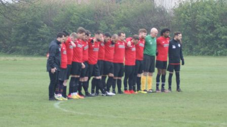 Highgate Albion thirds hold a minute's silence to honour Calvin Bungisa, who was a victim of knife c